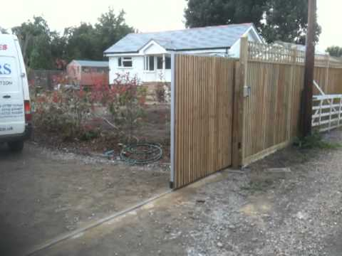 Wooden sliding electric gate part 1 youtube for Wooden sliding driveway gates