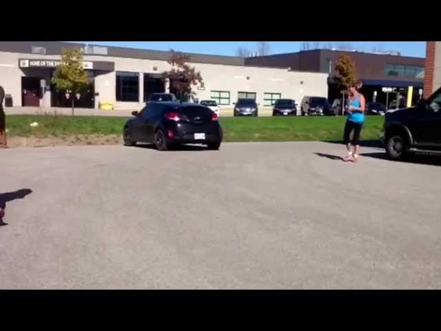 Coach Brian Nugent CrossFit POW leaps 5' car at age 36