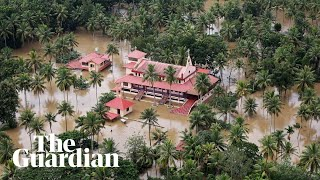Indian PM surveys flood damage in Kerala as the Air Force drops aid to victims