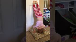 Lydia does headstands