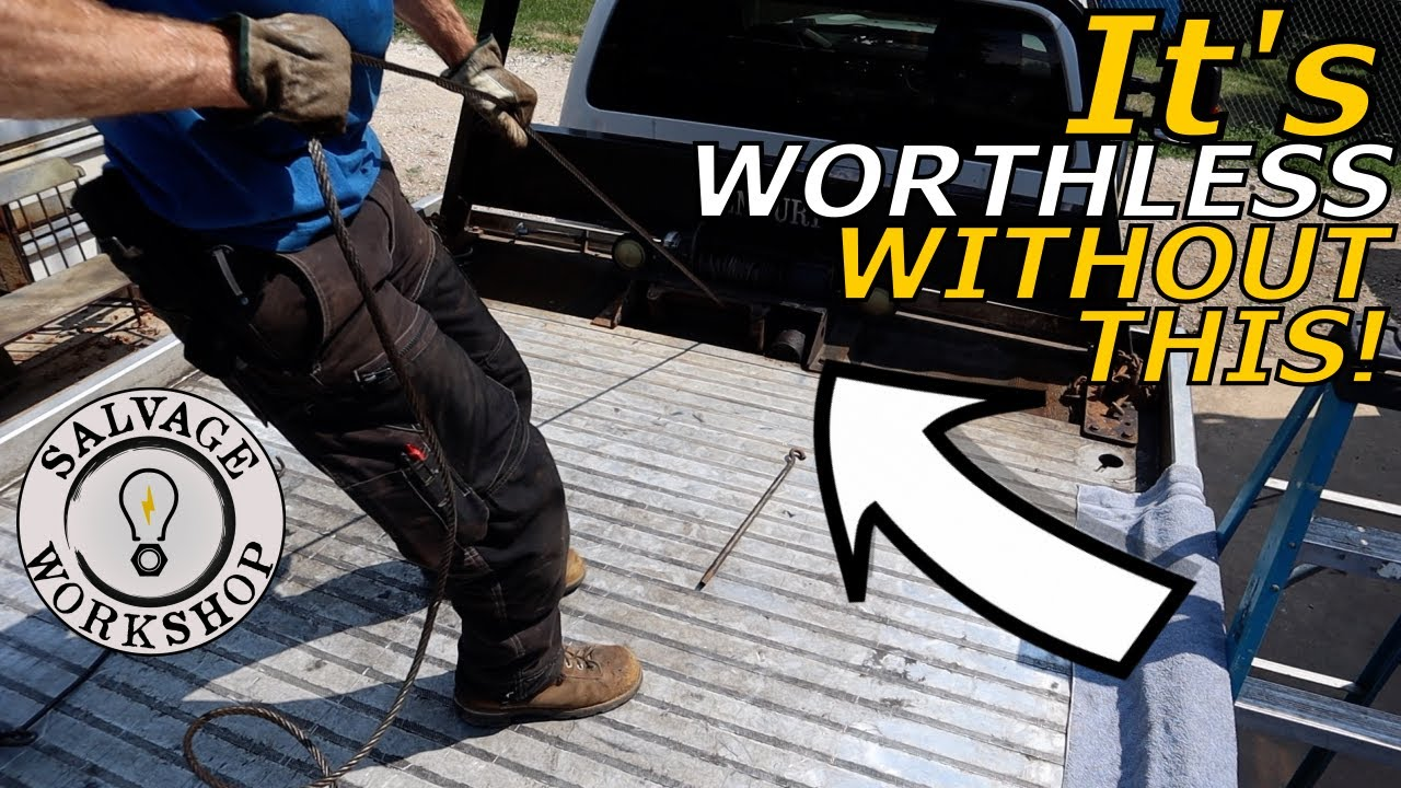 Repairing a Rescue Winch on a Flatbed Tow Truck