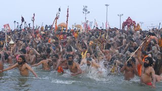 Indian Naga Sadhus bathing in the sacred water of Sangam at the Kumbh Mela, India