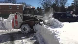 Bobcat 843 Plowing Snow