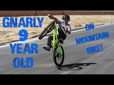 GNARLY 9 YEAR OLD ON MOUNTAIN BIKE!
