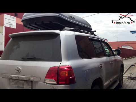 Тойота Ленд Крузер (Toyota Land Cruiser) с багажным боксом Farad Marlin 680 на крыше