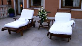 Dolly Shot Of Lounge Chairs On A Deck In Venice.