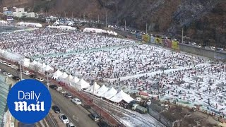 150,000 people attend ice fishing festival in South Korea - Daily Mail