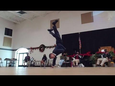 School Principal does breakdancing moves at the Faithful Ambassadors Bible Baptist Academy party