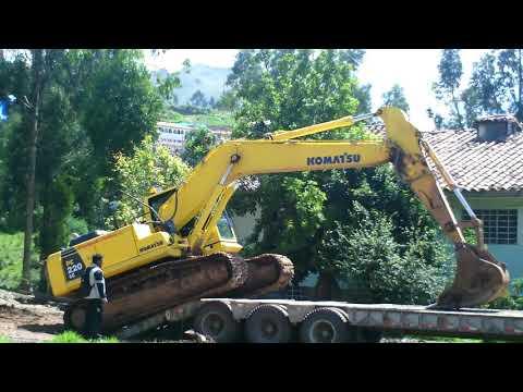 ¿Como Subir Una Excavadora A Un Cama- Baja?