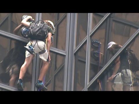 Man climbs up Trump Tower in New York City