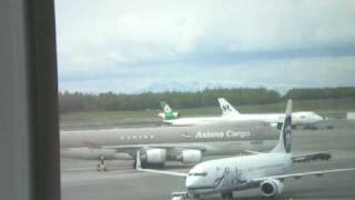 Planes taxiing and taking off at Ted Stevens International in Anchorage