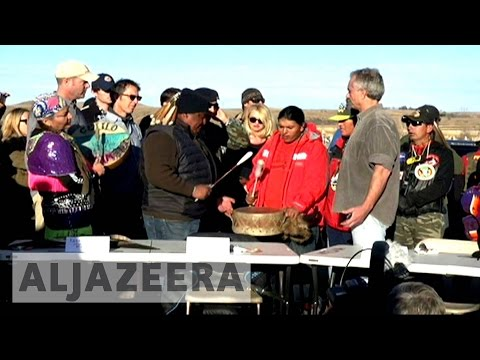 North Dakota pipeline: Native tribes defend sacred land