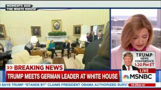 Trump and Merkel refuse to shake hands during White House pool spray