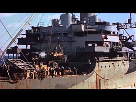 Rocket mortar crates transferred from ammunition ship to aircraft carrier at sea,...HD Stock Footage