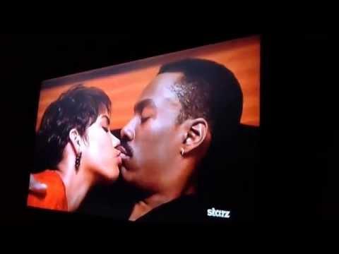 Marcus (Eddie Murphy) kisses Angela (Halle Berry) on Boomerang the movie
