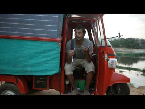 Naveen Rabelli and his self-designed /built solar tuk tuk he plans to drive from India to UK