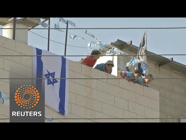 Jewish settlers take over disputed West Bank building