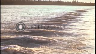 Barges loaded with supplies at a harbor for the Canol Project in Canada during Wo...HD Stock Footage