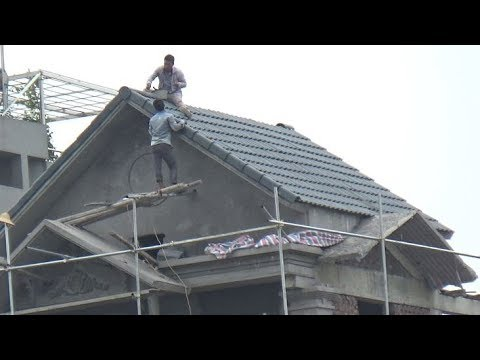 DANGEROUS!!! Workers Tiling On Top Sloped Roof Without Any Safety Equipment