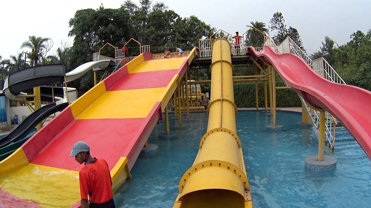 yellow tube water slide at aqua village