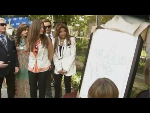 Michael Jackson's children attend an art donation