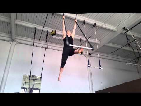 Beginner tricks on static trapeze