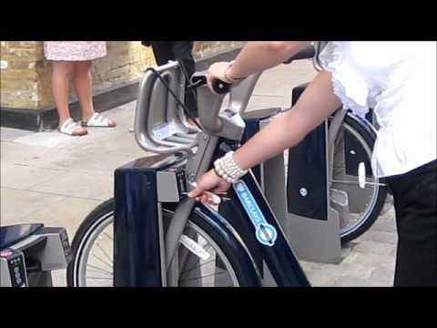 Cycle hire docking the bike