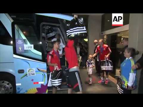 Victorious German players arrive back at team hotel