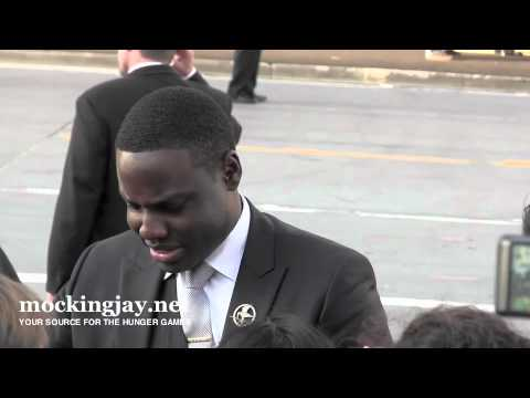 Dayo Okeniyi Signs for  at 'Hunger Games' Premiere