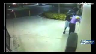 Raw video: Gunman wearing leather jacket robs woman