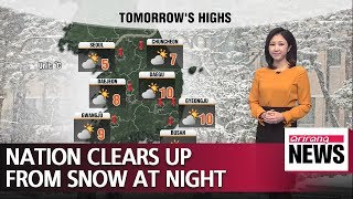Nation clears up from snow at night