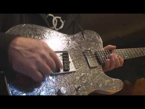 Liquid Metal Silver Dollar Paisley Guitar