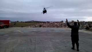 Helicóptero do Exército Brasileiro pousando no heliponto do Corpo de Bombeiros em Varginha