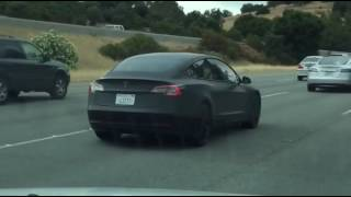 Tesla Model 3 on highway