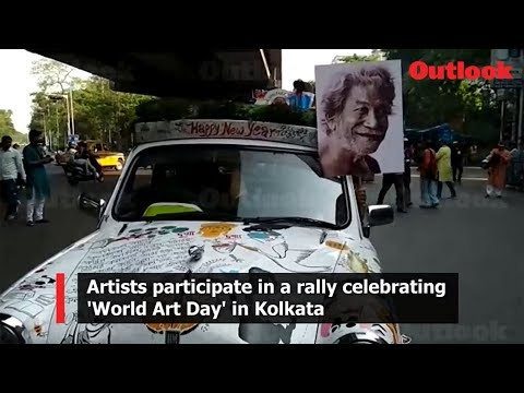 Artists participate in a rally celebrating 'World Art Day' in Kolkata