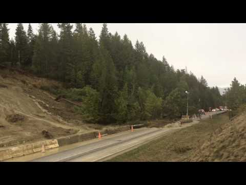 Active mudslide covers Idaho road - YouTube