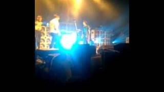 kid gets punched in the face by oli at concert