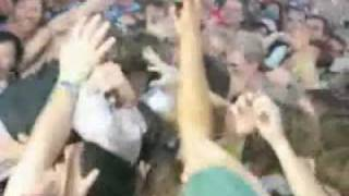 Win Butler of Arcade Fire stage dives during Power Out (at Coachella 2005)