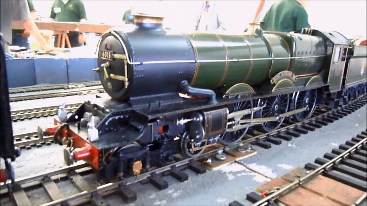 Circular layout at model railway exhibition with Thomas and many other O  and OO gauge locomotives