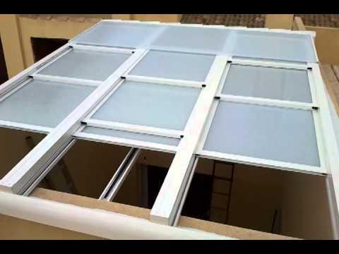 Cerramiento aluminio con motor corredizo pergolas de for Toldos y cerramientos para patios
