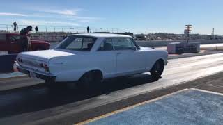 White Chevy Nova Drag Race
