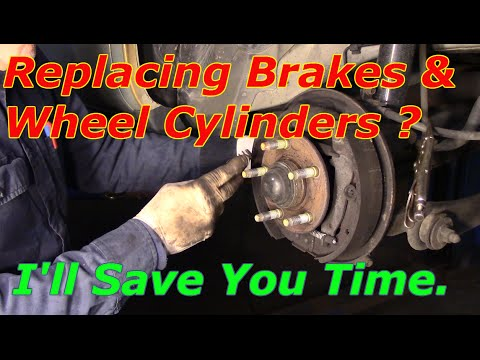 How To Replace Rear Brakes And Wheel Cylinders On A 2003 Ford Taurus