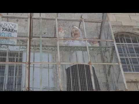 Palestinian Woman Caged In Home
