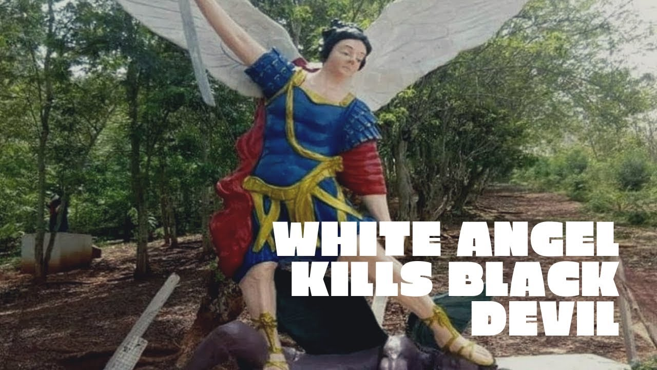 White Angel killing Black devil statue in Ghana