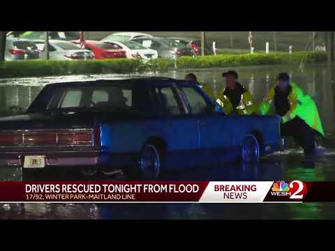 Drivers rescued from flood waters at Maitland-Winter Park line