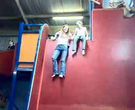 Sister terrified of a little slide