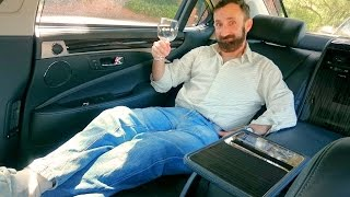 Riding in the luxurious back seat of the $140K Lexus LS 600h L