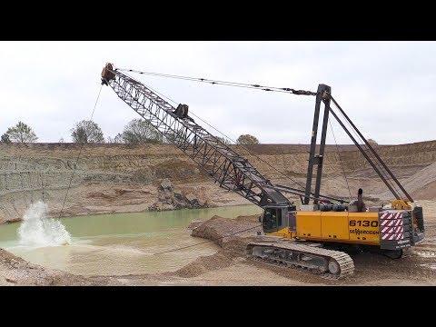 Big 110 Ton Sennebogen 6130 Dragline Digging Gravel Under Water