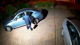 Thief trying to open my car doors in my drive