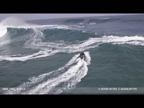 Eaten alive tow in surfing at Jaws and rescue. Heli Shots by
